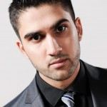 Studio portrait photograph young man in business suit