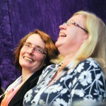 Conference photograph Leicester - speaker panel member laughing