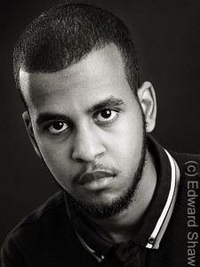 Black and white studio portrait, publicity headshot photo of actor Warsame