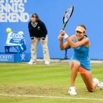 Ana Ivanovic kneeling backhand from baseline