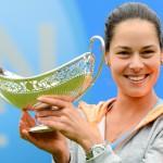 Winner Ana Ivanovic, holding the Maud Watson Trophy